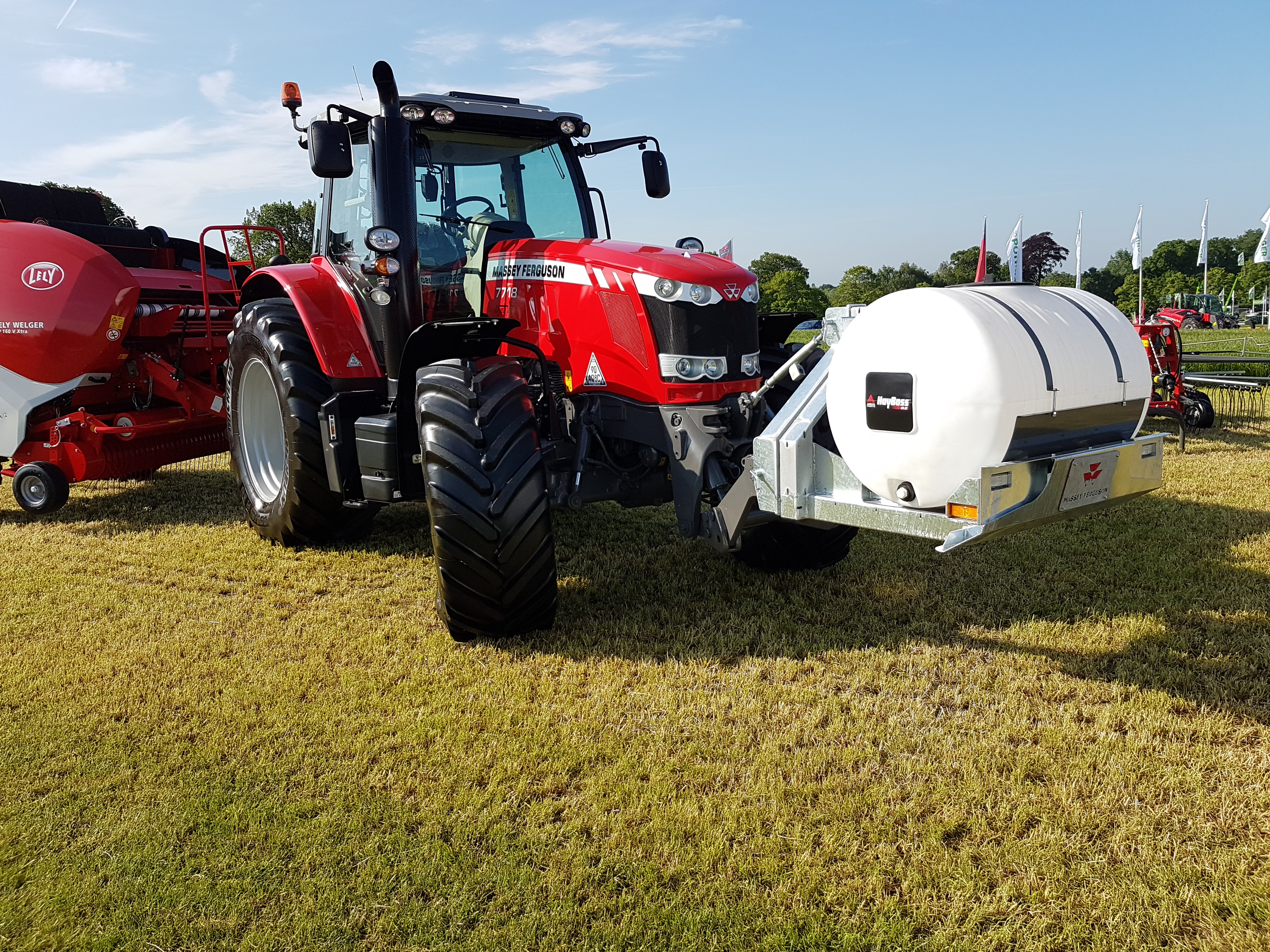 Front mounted HayBoss applicator