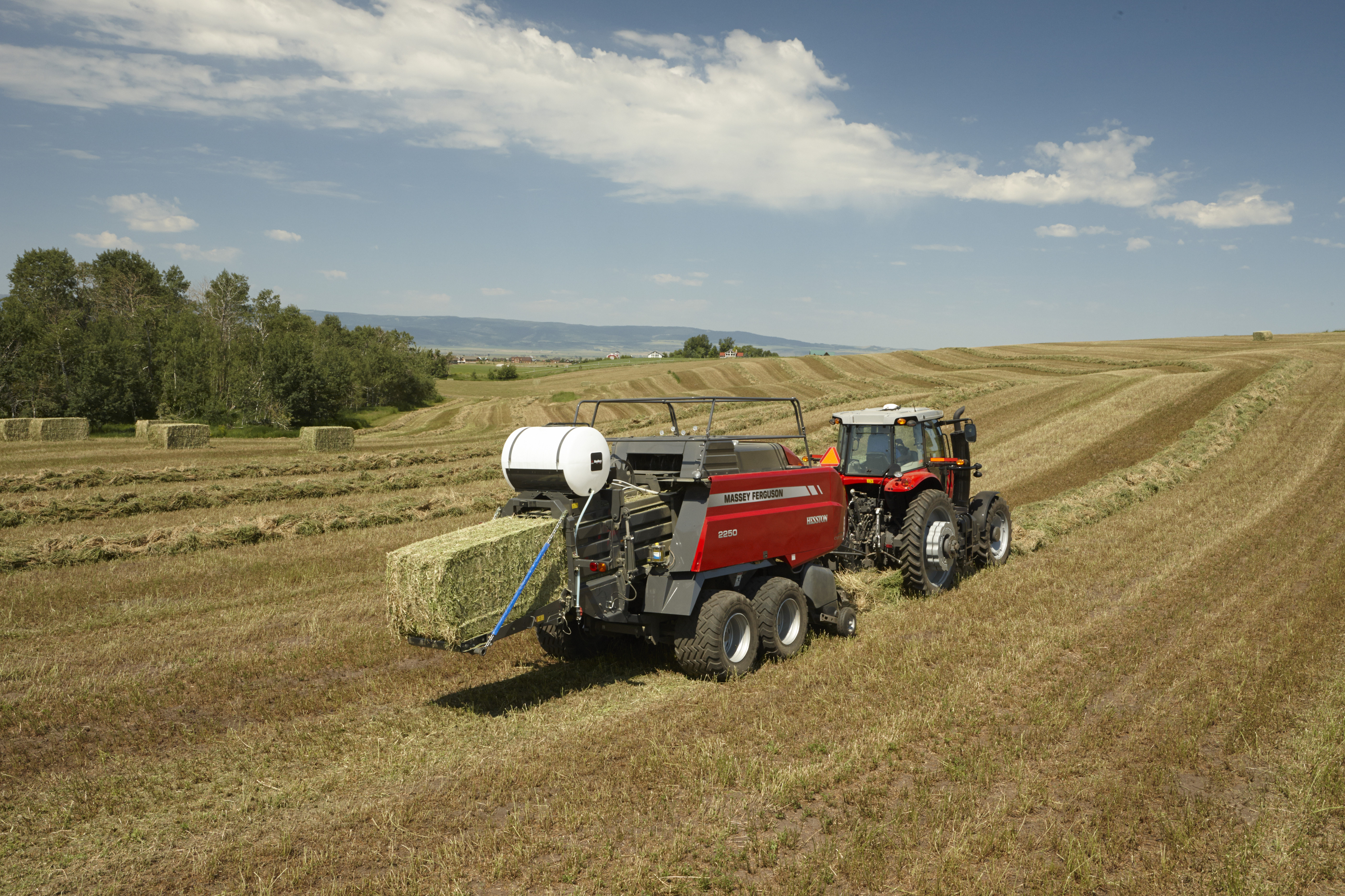 MF large square baling hay with Baler's Choice